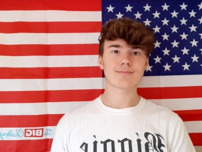 """Schermbeck  Gesamtschule-Schermbeck  This is a photo of me in front of a flag of the USA that I've won at """"The Big Challenge"""" done with a selfiestick also won at this competition. So I hope that I win something in this year too. Best wishes  Jacob Butteweg"""