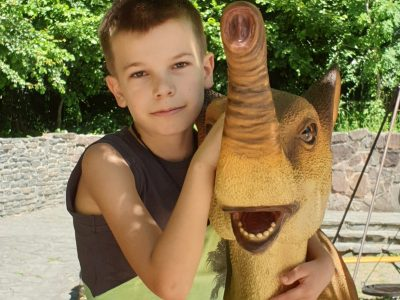 Euskirchen, Emil- Fischer- Gymnasium   This photos shows me with a Dino at the Dino- Park Teufelsschlucht. That´s my favourite photo from the visit.
