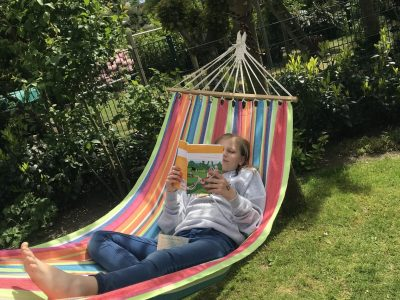 """Ratsgymnasium Gladbeck  I'm reading my englischbook """"The wildest party ever"""" on my favourite place in the garden my han mat. :-)"""