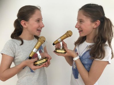 Potsdam, Hermann von Helmholtz-Gymnasium, Klasse 6a My twin sister and myself got these microphones at Madame Tussauds in London, 2019. We took the picture today after finishing the Big Challenge.