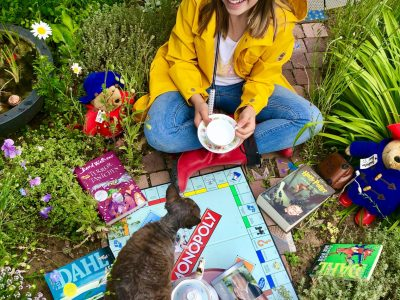 Elsenfeld Julius Echter Gymnasium   Sitting in our English garden, drinking English tea and playing Monopoly with my Devon Rex cat and Paddington Bear.  Megan Hessler with Mia