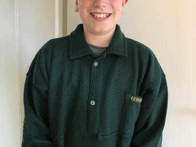 Hemsbach, Bergstraßen-Gymnasium  Dargestellt ist ein englischer Junge mit einer englischen Flatcap und einem Sweatshirt der Guinness-Brauerei.