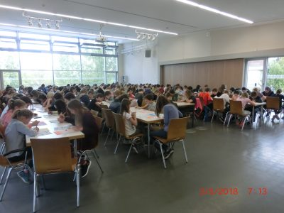 The students are sitting in our auditorium. They are 171 students from Otto Schott Gymnasium Jena in Germany and this is the largest number ever in our history. The caretakers had to bring in a whole row of new tables and chairs. Thank you for the opportunity.