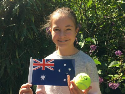 Hello, my name is Finja Übrick. I live in Neuss and I go to Nelly-Sachs-Gymnasium. I took a picture with the Australian flag and with a tennis ball from the Australian Open in Melbourne, because my sister just came back from Australia. I love tennis and I love to take pictures. That´s why I would  be super happy to win the camera. Best regards, Finja Übrick