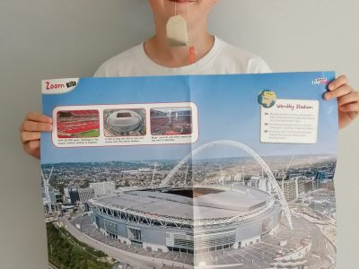 Meerbusch, Städtisches Meerbusch Gymnasium (SMG)  Hello,  I hope you can see, that the picture on the poster shows the Wembley Stadium, because I love football. In my mouth I have some tea, because I like British teatime.  Yours Bennit