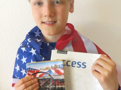 Ulm, Kepler-Gymnasium Ulm Here is my photo that shows me, my sister's Big Challenge-flag, my excersice book and a book with stories about travels through America. Now I only have to wait for my new sports camera.