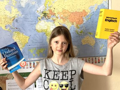 I am Maria Trepakova from Gymnasium Gröbenzell. I am eleven years old and I love England. I dream to go to London,  therefore I marked it on my map behind me. I like to learn different languages,  especially English. I hope,  I win.