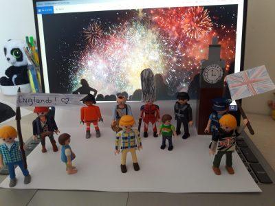 Colombes  Marguerite Duras WANNIARACHCHIGE DON   Ceci est une photo qui represente des personnes en train de feter St George's Day on peut voir un soldat ,le big ben ,des citoyens,des feux d artifices....