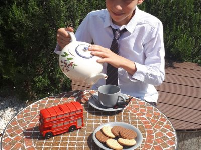 One of the students of the royal college CAMILLE CLAUDEL of LAUNAGUET in Toulouse taking his afternoon tea in the garden.