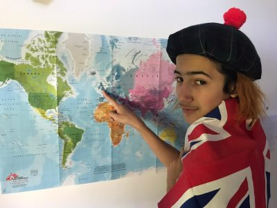 Fontainebleau, College International Theo is showing us the Union Jack, the national flag of the United Kingdom and wearing a 'Tartan Tammy', the traditional Scottish bonnet.