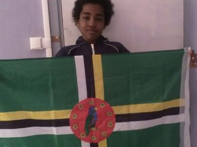 This the flag or Dominica. A former British colony.