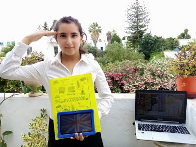 From the french school Gustave Flaubert of La Marsa (Tunisia) ROCCHEGGIANI Sara Proud to send you my picture with the English flag + my Greetings to the Queen Elizabeth II + my English High School uniform (made by my self)
