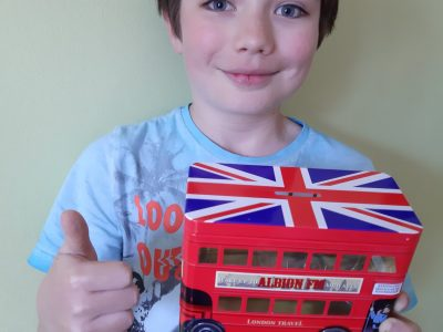 My name is Thibaut and I'm in Collège Sainte Ide in Lens. I send to you my photo because I love English and I have bought this piggy bank in London last Year which represents a London Bus .I would like to win this sport camera. Bye Bye. Take care of yourself.