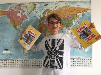 I live in Caen where I study at the Louis Pasteur college. I took this photo with my two English books and against the background of a world map with England.